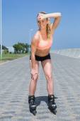 Fit blonde rollerblading on promenade — Stock Photo