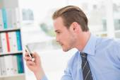 Focused businessman text messaging — Stock Photo