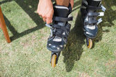 Man putting on his roller blades — Stock Photo