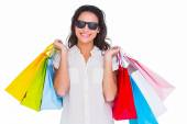 Pretty brunette with shopping bags — Stock Photo