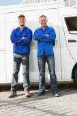 Smiling handymen looking at camera — Stock Photo