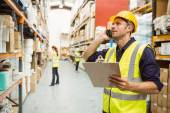 Warehouse worker talking on the phone — Stock Photo