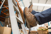 Worker falling off ladder in warehouse — Stock Photo