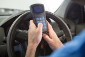 Mechanic using diagnostic tool in the car — Stock Photo