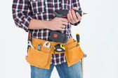 Handyman holding drill machine — Stock Photo