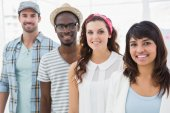 Smiling colleagues standing and posing in a line — Stock Photo