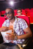 Young friends watching a 3d film — Stock Photo