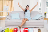Brunette with many shopping bags — Stock Photo