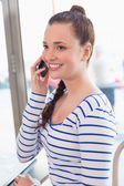 Woman talking on the phone at cafe — Stock Photo