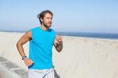 Fit man jogging on promenade — Stock Photo
