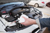 Close up of man checking car engine oil — Stock Photo