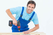 Carpenter using drill machine on wood — Stock Photo