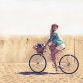 Cute blonde on a bike ride — Stock Photo