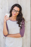 Brunette holding take away coffee — Stock Photo