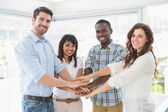 Happy coworkers joining hands in a circle — Stock Photo