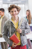 Fashion student smiling at camera — Stock Photo