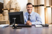 Warehouse manager with laptop at desk — Stock Photo