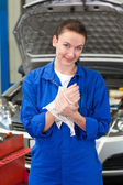 Mechanic wiping hands with rag — Stock Photo