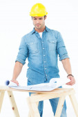 Architect analyzing blueprint at table — Stock Photo