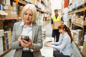 Focused warehouse manager using handheld — Stock Photo