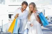 Couple looking at their shopping purchases — Stock Photo