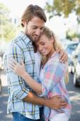 Attractive couple standing and hugging — Stock Photo
