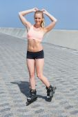 Blonde rollerblading on promenade — Stock Photo