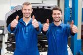 Team of mechanics smiling at camera — Stock Photo