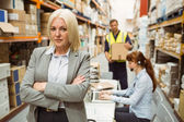 Serious warehouse manager standing arms crossed — Fotografia Stock