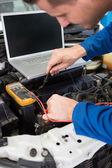 Mechanic using diagnostic tool on engine — Stock Photo