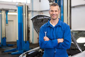 Mechanic smiling at the camera — Foto Stock