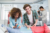 Students working together with a fabric — Stock Photo