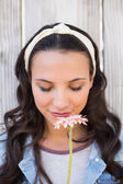 Pretty hipster smelling a flower — Stockfoto