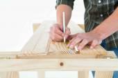 Carpenter marking on wooden plank — Stock Photo