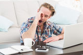 Tired man working and yawning — Stock Photo