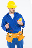 Repairman examining multimeter — Stockfoto