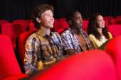 Young friends watching a film — Stock Photo