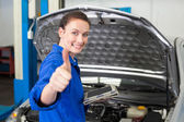 Mechanic using tablet to fix car — Stock Photo