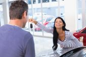 Smiling woman holding her new key — Stock Photo