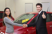 Persons shaking hands in front of sold car — Stock Photo