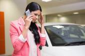 Sad woman calling someone with her mobile phone — Stock Photo