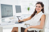 Businesswoman using digitizer at desk — Stock Photo