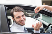 Businessman getting his new car key — Stock Photo