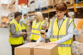 Warehouse workers preparing a shipment — Stock Photo