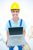 Repairman holding laptop — Stock Photo