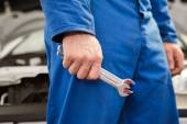 Mechanic standing with wrench in hand — Stock Photo