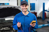 Mechanic smiling holding tool — Stockfoto