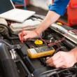 Mechanic using diagnostic tool on engine — Stock Photo #65560775