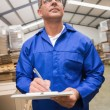 Warehouse worker checking his list — Stock Photo #65561289