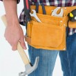 Repairman wearing tool belt holding hammer — Stock Photo #65561383